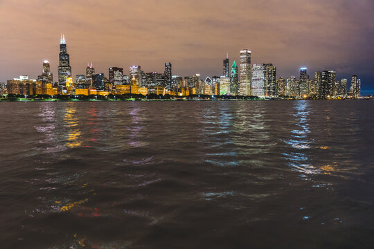 View of Lake Michigan and city skyline at night from Adler planetarium, Chicago, USA