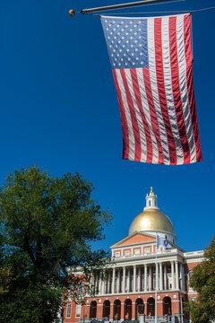 Massachusetts State House and American flag, Boston, Massachusetts. USA