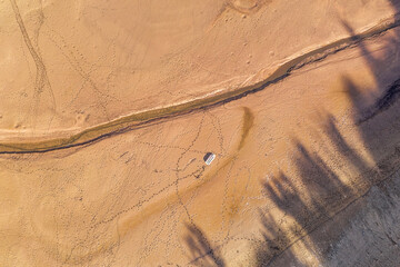 a dry lake with a boat from above