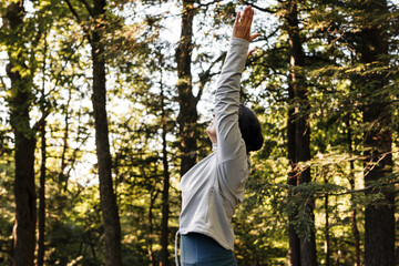 Side view of senior woman doing yoga outdoors