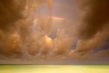 Storm clouds and rainbow over Caribbean Sea
