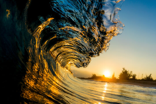 Close up of wave in sea during sunrise