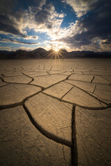 View of cracked desert landscape during sunrise