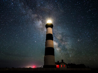 Bodie Island Lighthouse against starry sky at night