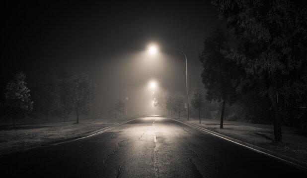 Street light illuminated on road at night
