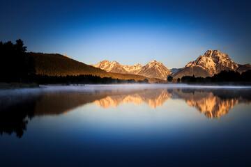 Reflection of Mount Moran in Snake River during sunrise