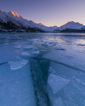 View of Mount Cook with frozen Tasman Lake in foreground