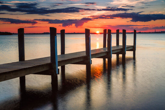 Sunset over pier on Indian River in South Hutchinson Island, Florida