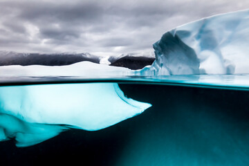View of iceberg with glacier in background