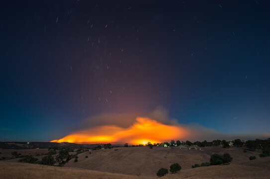 View of fire burning on landscape at night