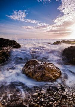 Long exposure of sea waves splashing on rocks at Shell Beach