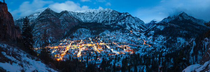 Scenic view of Ouray town against mountain range at dusk