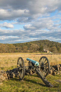 View of cannon on civil war battlefield in Gettysburg National Military Park