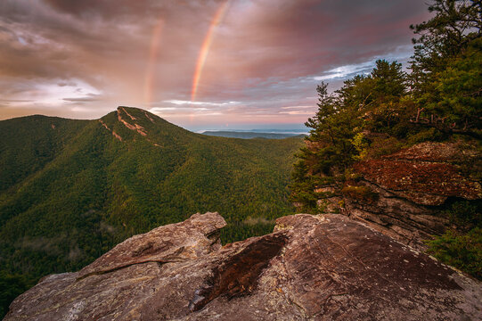 Double rainbow over Hawksbill Mountain in Linville gorge, Pisgah national forest during sunset