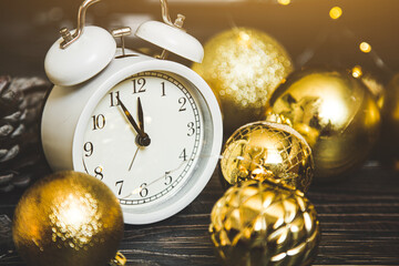 change from 2020 to 2021 on the clock. New Years Eve and Christmas. Alarm clock and Christmas golden balls
