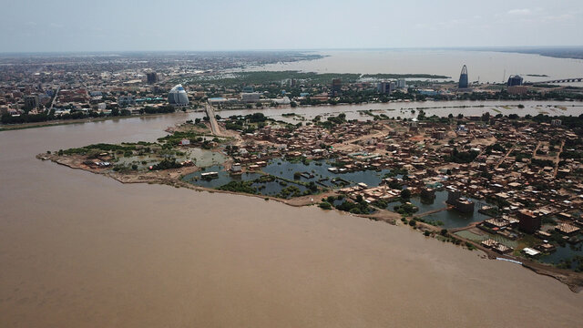 An aerial view shows buildings and roads submerged by floodwaters near the Nile River in South Khartoum