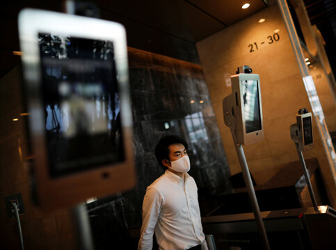 Facial recognition and elevator navigation systems are seen at the entrance hall of SoftBank's new headquarters building in Tokyo