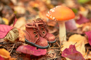 Brown leather toy shoes. Selective focus.