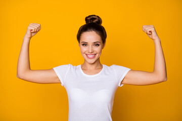 Portrait of cheerful strong super woman show her muscles she training sportive finess workout wear good look clothes isolated over vivid color background