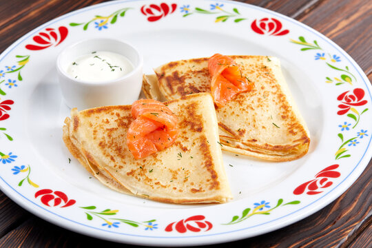 pancakes with salmon and sour cream