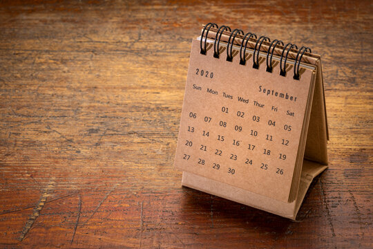 September 2020 - spiral desktop calendar on rustic, weathered wood, time and business concept
