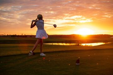 Golfer Woman Professionally Hit Ball .