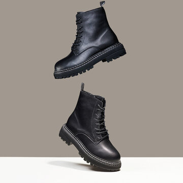 Black boots in the air. fashion shoes still life