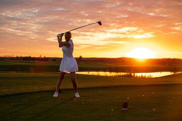 Lovely Woman in Uniform Hit Golf Ball .