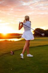 Professional Golfer Female Observes Ball Flight .