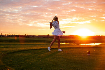 Silhouette of Blond Woman Play Golf .