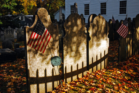 An American flag is placed on a grave of a soldier who fought in the American Revolution at the graveyard of the First Congregational Church in Bennington Vermont