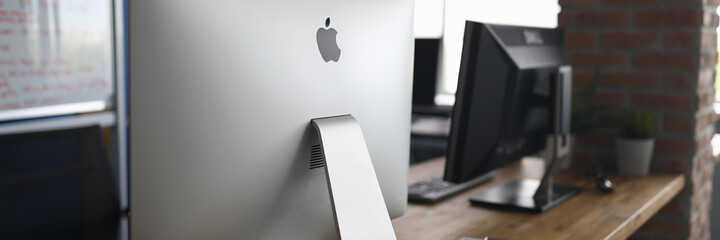 Apple Imac pc against empty office background
