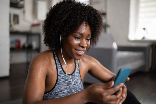 Sweaty black woman listening to music