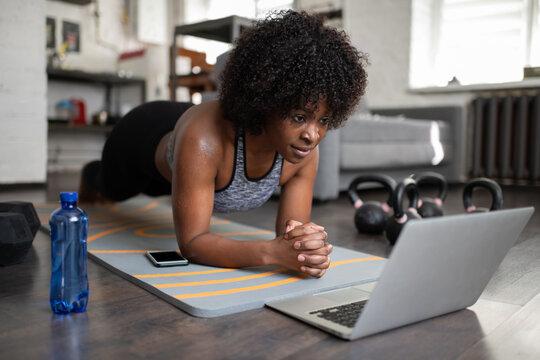 African American sportswoman doing plank