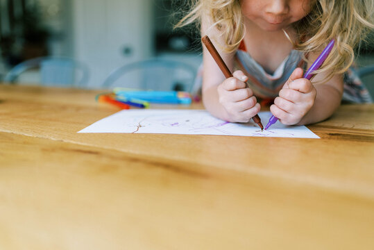 Stock portrait of a little toddler girl drawing