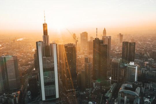 Incredible View of Frankfurt am Main, Germany Skyline in on Hazy Winter morning in Beautiful Sunrise Light