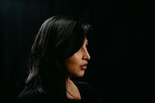 dramatic portrait of beautiful hispanic woman