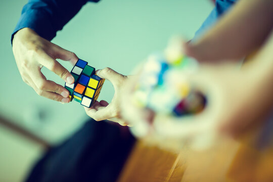 Bangkok, Thailand - September 9, 2020 : Business man holding Rubik's cube - technical and business solving problem and brain training concept