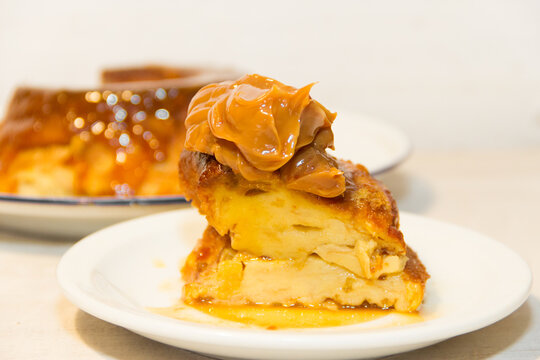 bread pudding made with stale bread, milk, eggs and sugar, decorated with liquid caramel and dulce de leche