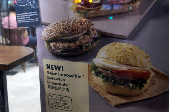 A poster showing product from plant-based burger maker Impossible foods been using at Starbucks, in Hong Kong
