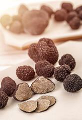 Whole and sliced black truffle
