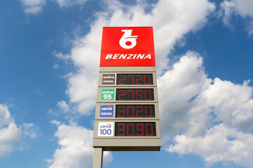 Ostrava, Czech Republic / Czechia - September 3, 2020: Benzina gas and patrol station. Brand logo of the company, firn and corporation on the price display board.