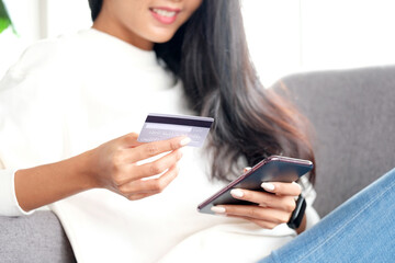 Online phone payment by credit card at home, Asian woman using mobile phone make digital money...
