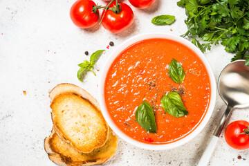 Tomato soup at white table.