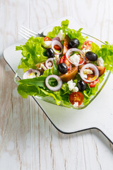Greek salad with feta cheese, black olives and onion