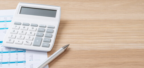 Calculator and a pen with copy space