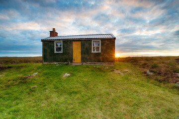 Wall Mural - Sunset over a shieling hut on Pentland Road near Stornoway