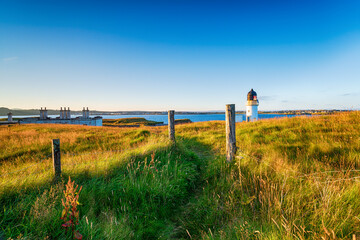 Wall Mural - The lighthouse and coastguard cottages at Arnish Point
