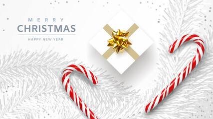 Merry Christmas and Happy New Year banner. Xmas background design of white pine branches, with realistic gift box, white confetti, sweets, candy canes, lollipops