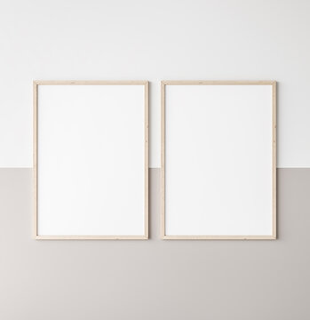 Mockup poster frame, two vertical wooden frames on beige and white wall, 3d render